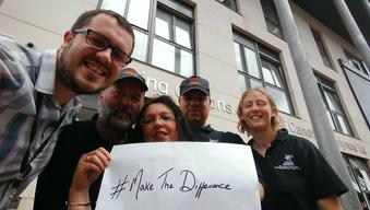 Colleagues who work to help homeless people in the city take a selfie